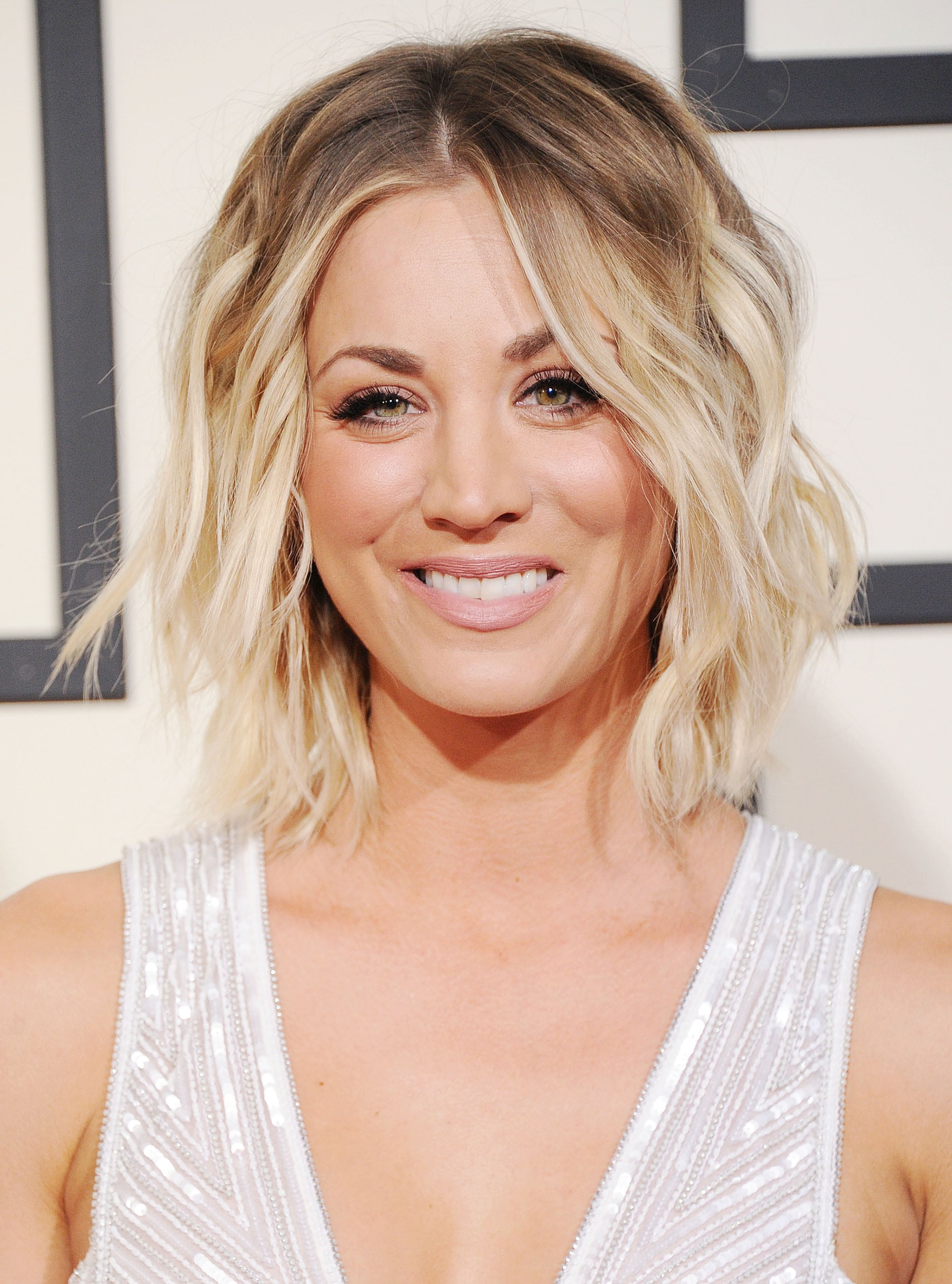 Angled bob: Kaley Cuoco with a wavy brown to blonde ombre angled bob