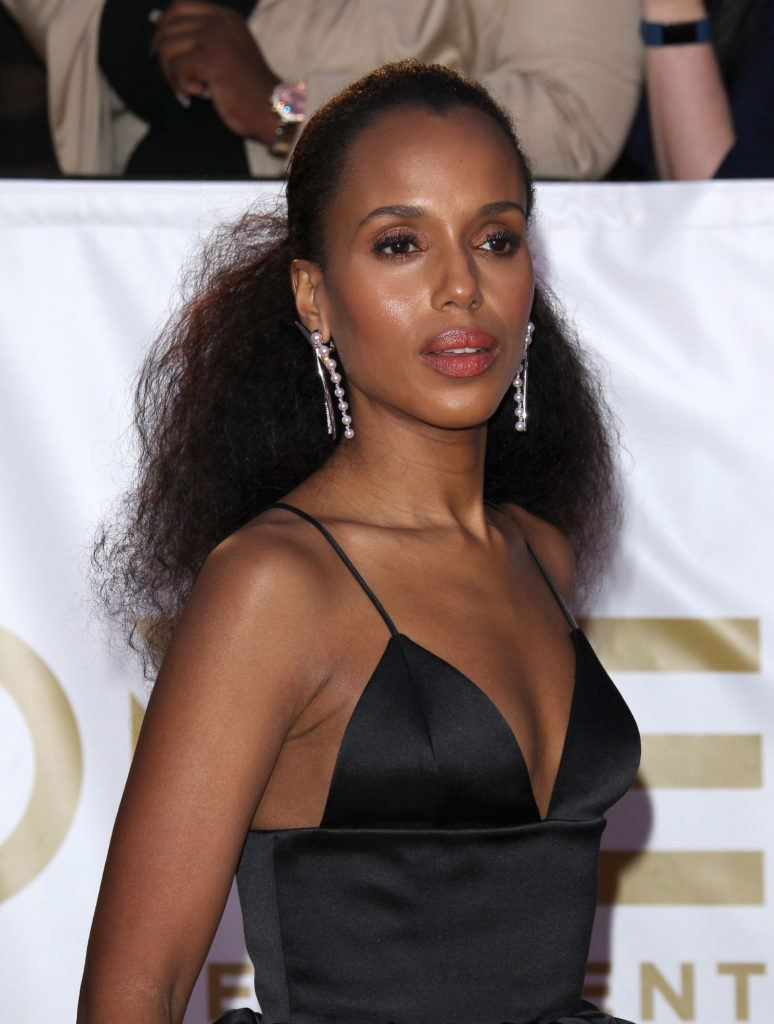 close up shot of kerry washington with natural low ponytail, with black strappy dress on the naacp image awards