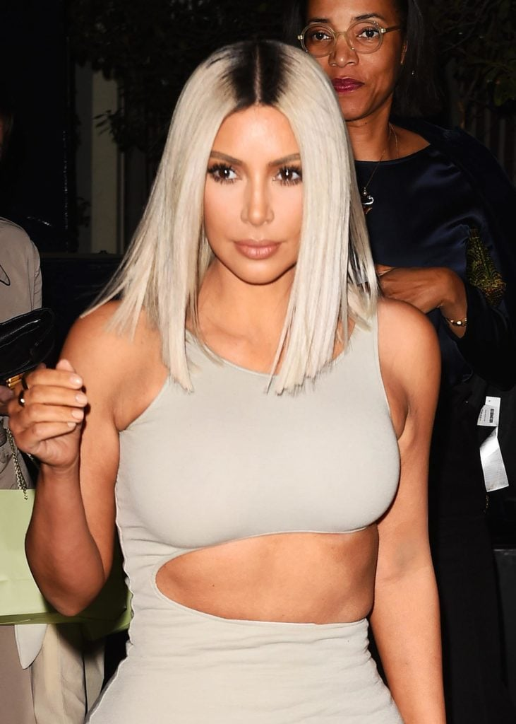 Kim Kardashian with a silver bob and dark grown out roots