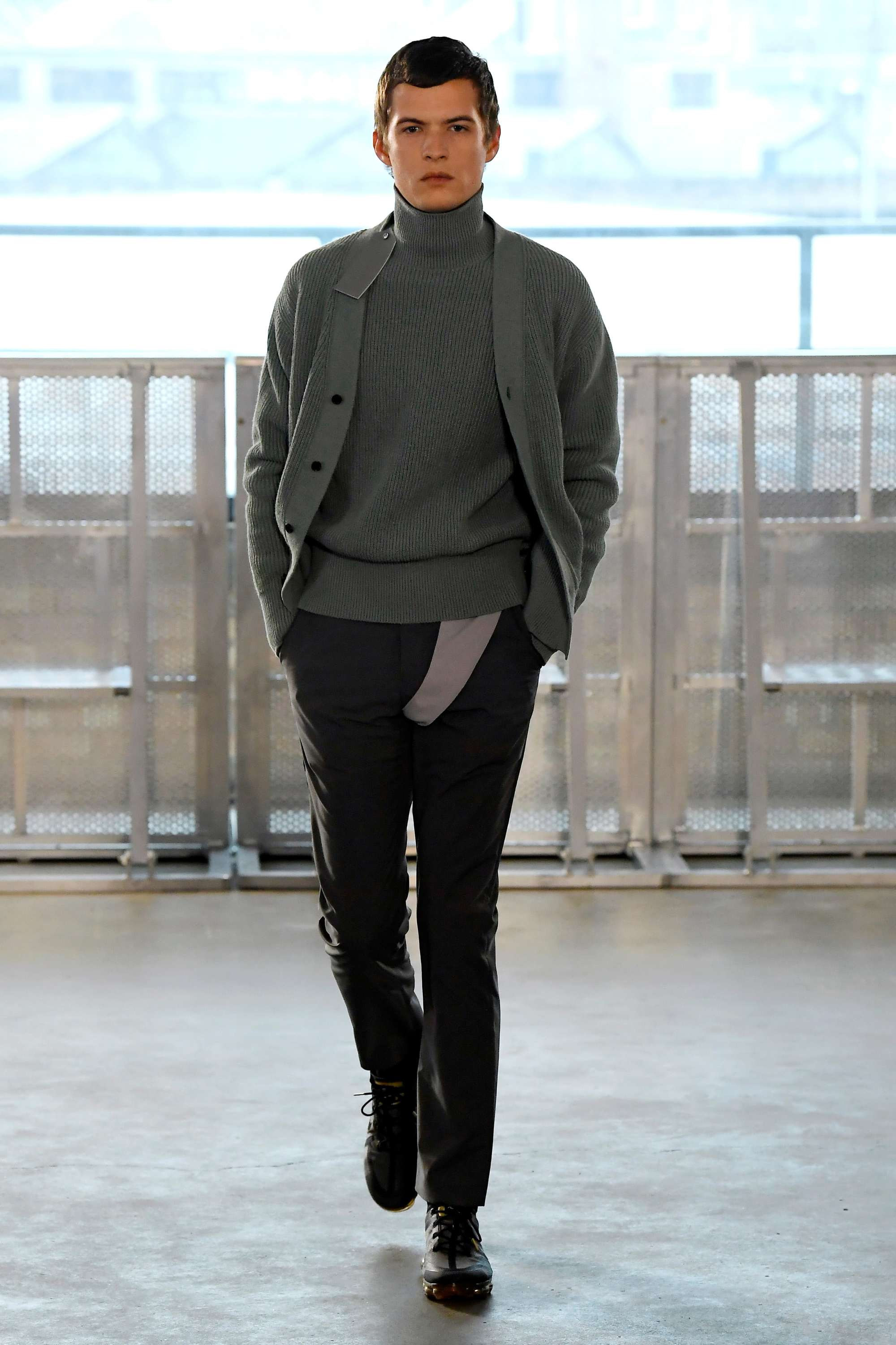 London Fashion Week Men's: Model on Xander Zhou runway with brown suave hairstyle.
