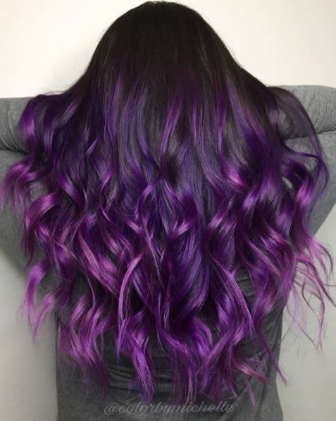 back view of woman with long purple ombre hair