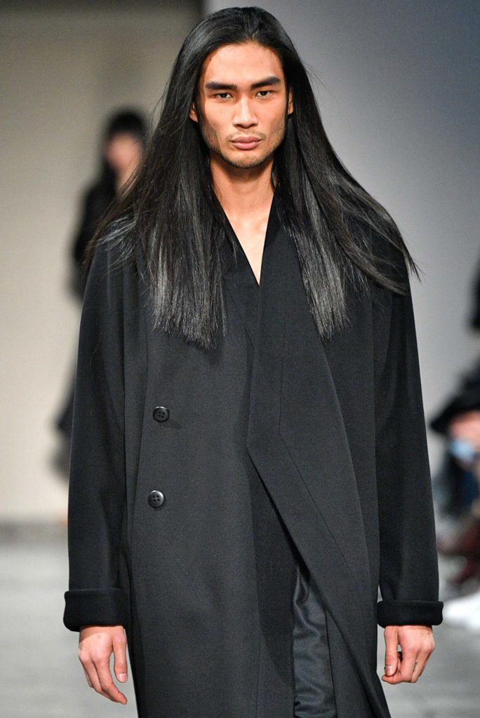 male model on catwalk with long dark straight hair