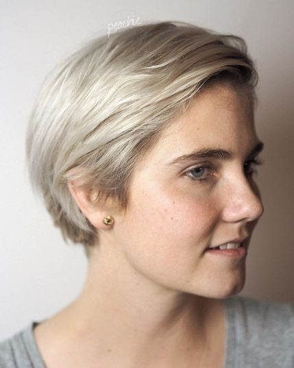 woman with a long silver blonde pixie cut