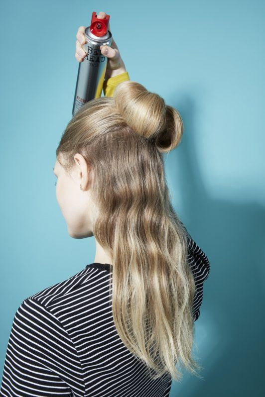 Bow hairstyle Hair bow tutorial blonde girl spraying hairspray over finished hairstyle