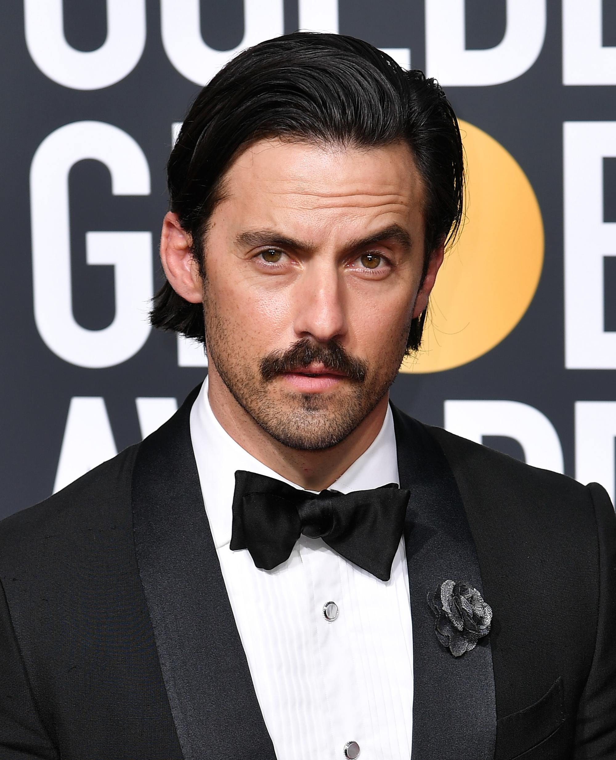 milo ventimiglia medium length dark brown hair in side parted swept back style