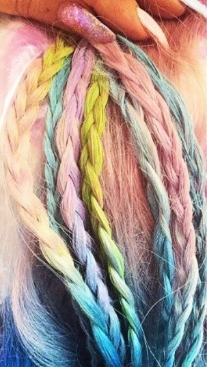 close up of different coloured hair chalk braids