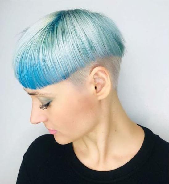 woman with pastel blue mushroom bowlcut