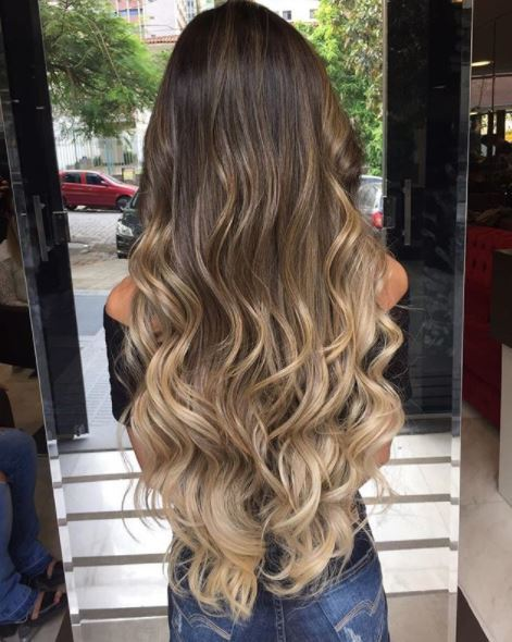 back view of woman with long brown ombre wavy hair