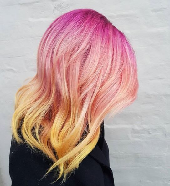 side view of pink and yellow ombre hair