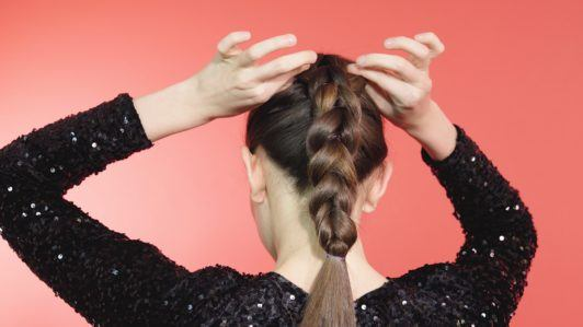 Pull through braid brunette girl separating braid with hands