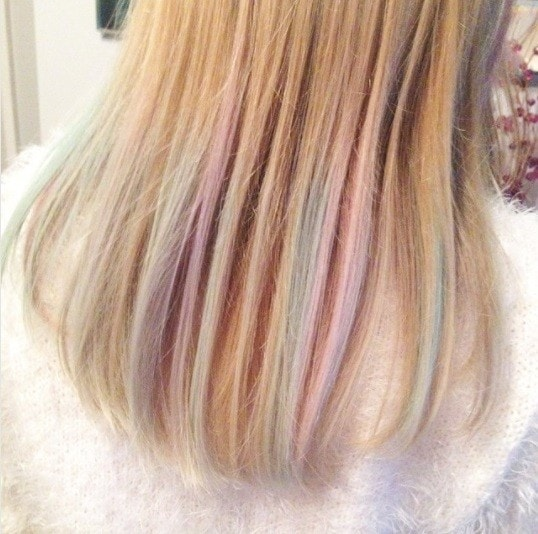 blonde with light pastel hair chalk through the ends of her hair
