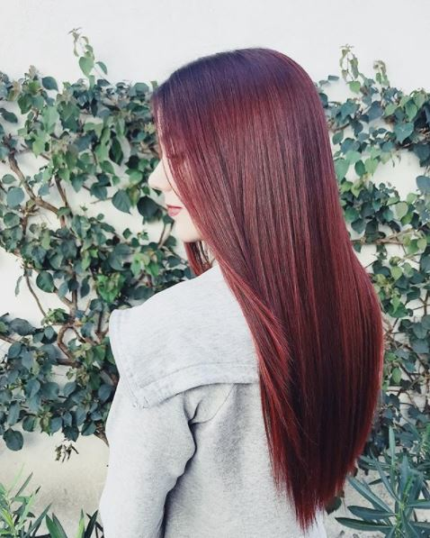 woman with long straight dark red hair