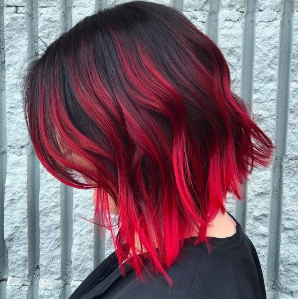 side view of black hair with red ombre colour