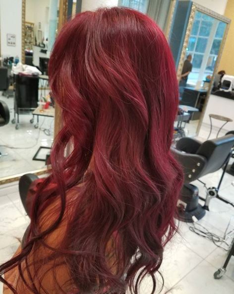 woman with deep red long wavy hair