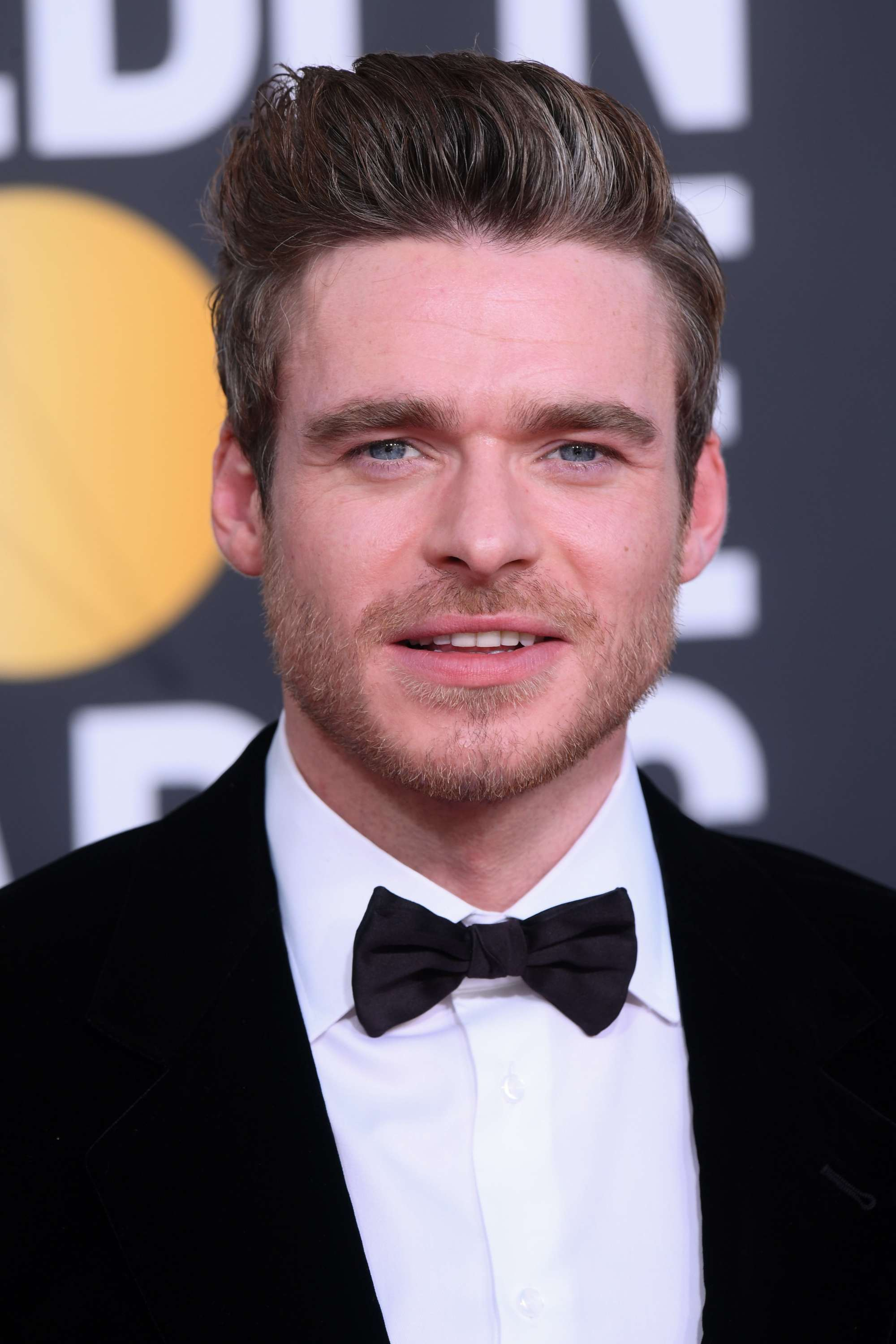 Golden Globes 2019: Richard Madden with brown hair with a grey streak, styled in a quiff