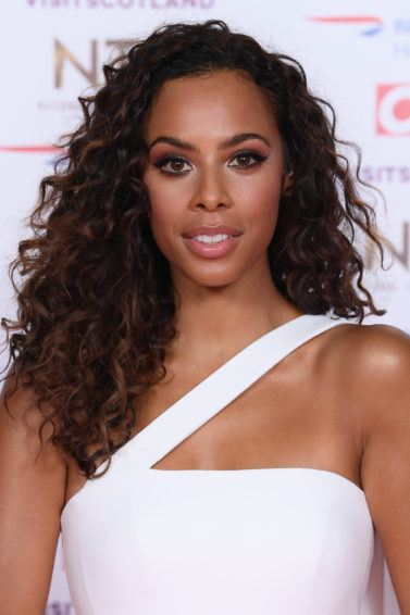 National Television Awards 2019: Rochelle Humes with medium long defined curls, wearing a white dress on the red carpet