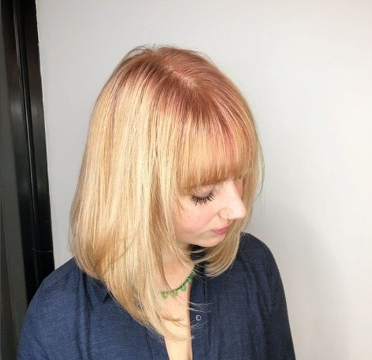 shot from above of a woman with rose gold shadow roots hair