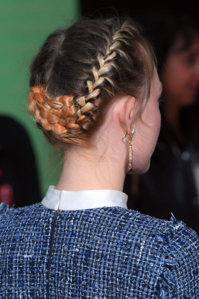 close up shot of saoirse ronan with two french braids pinned up into a elegant updo hairstyle