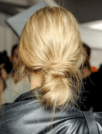 Banana bun hair blonde girl backstage close up on bun