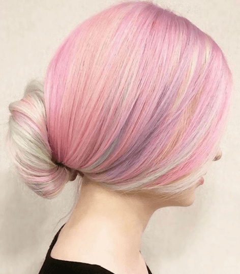 Banana bun style on mulitcoloured pink rainbow hair