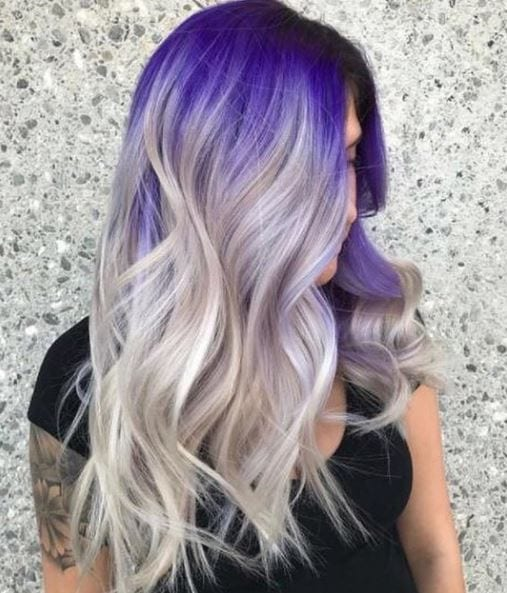 side view of purple roots on silver long wavy hair