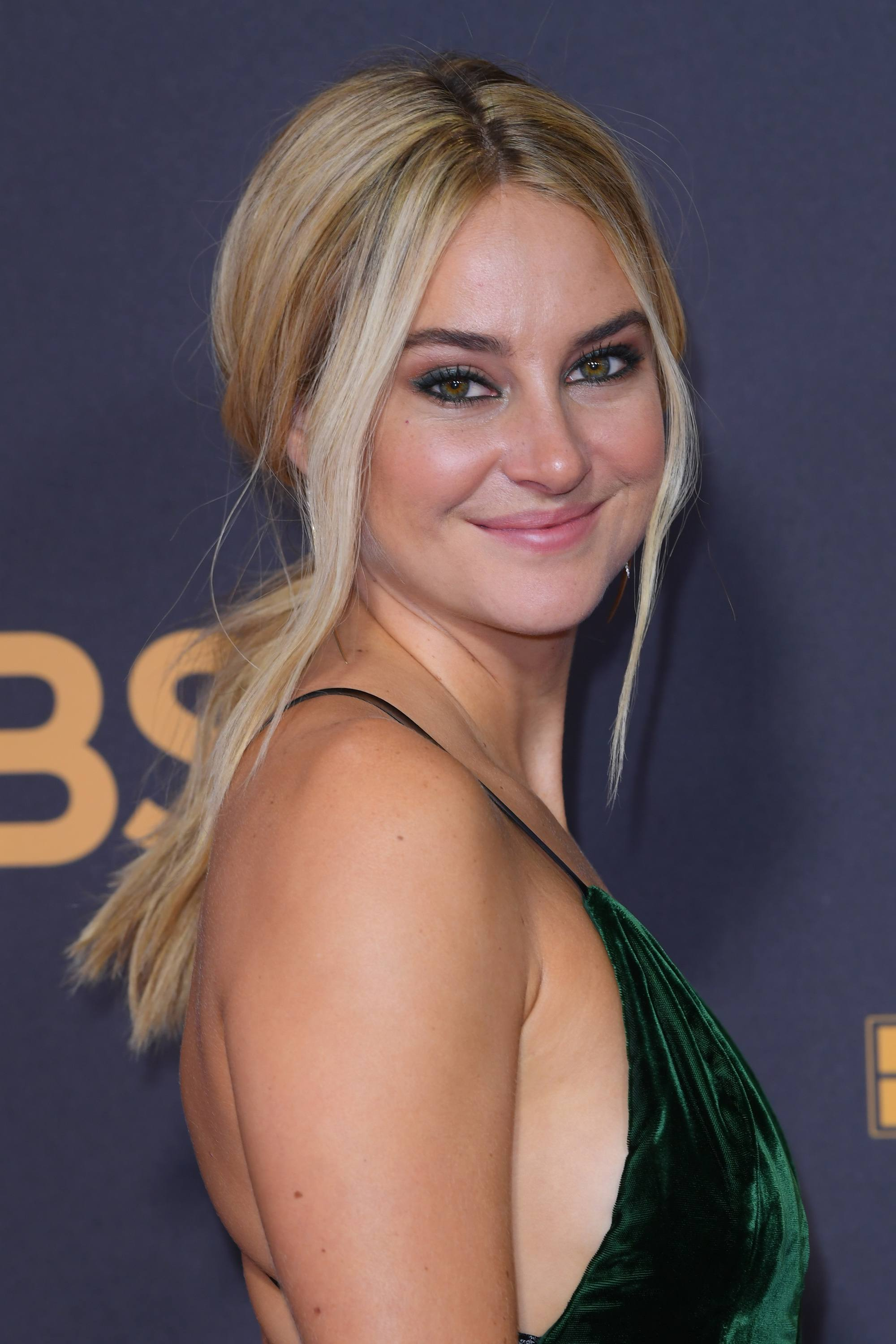 triangle face hairstyles: actress shailene woodley with blonde hair styled in a low ponytail with a few loose strands around her face