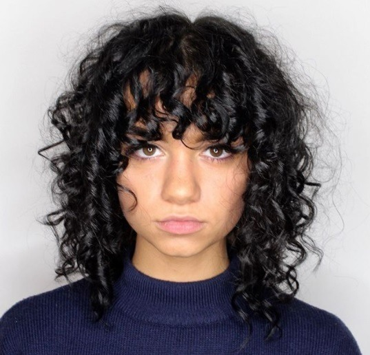 Woman With Gy Curly Bob Length Hair Bangs