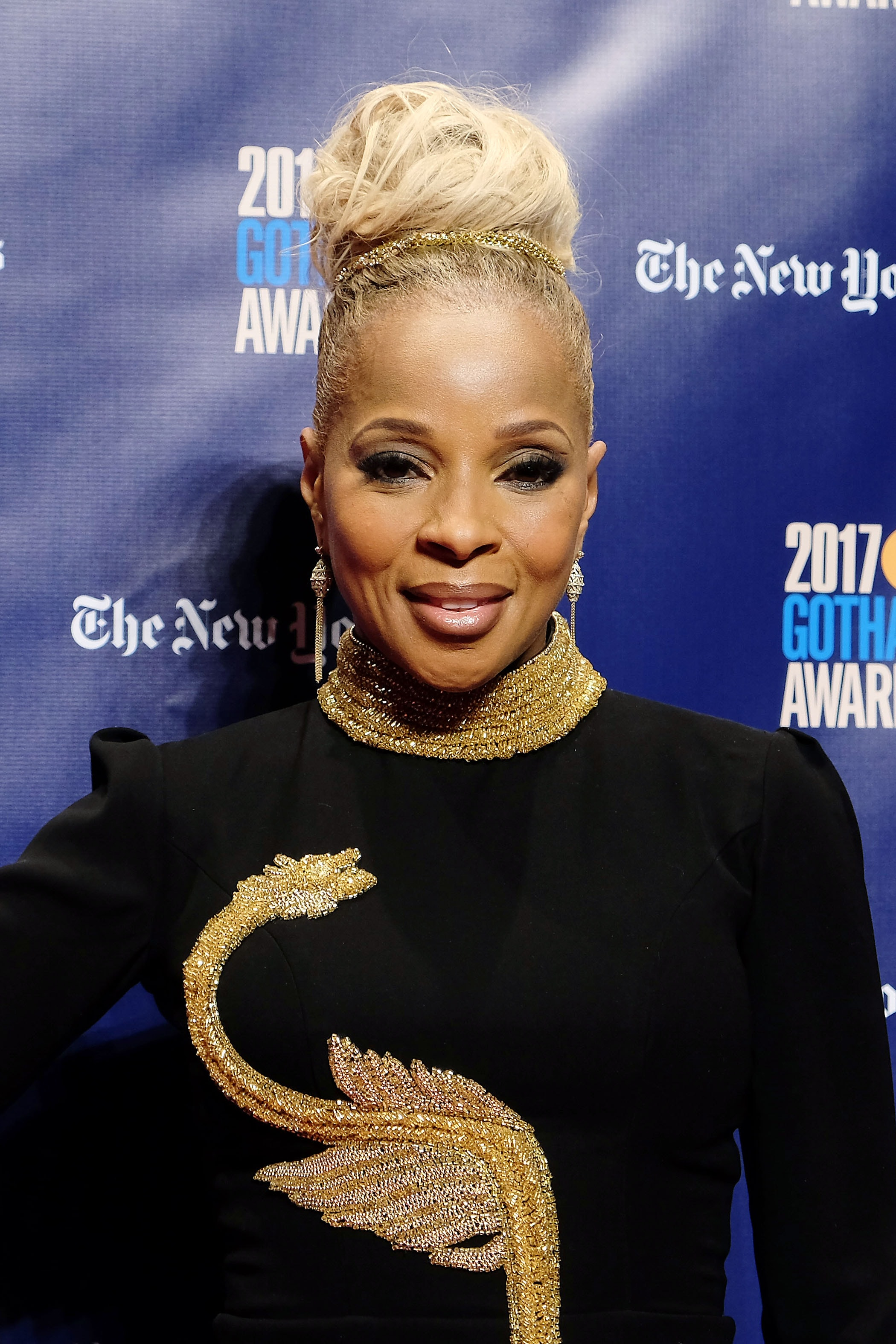 Mary J Blige at wearing a high bun hairstyle on the red carpet
