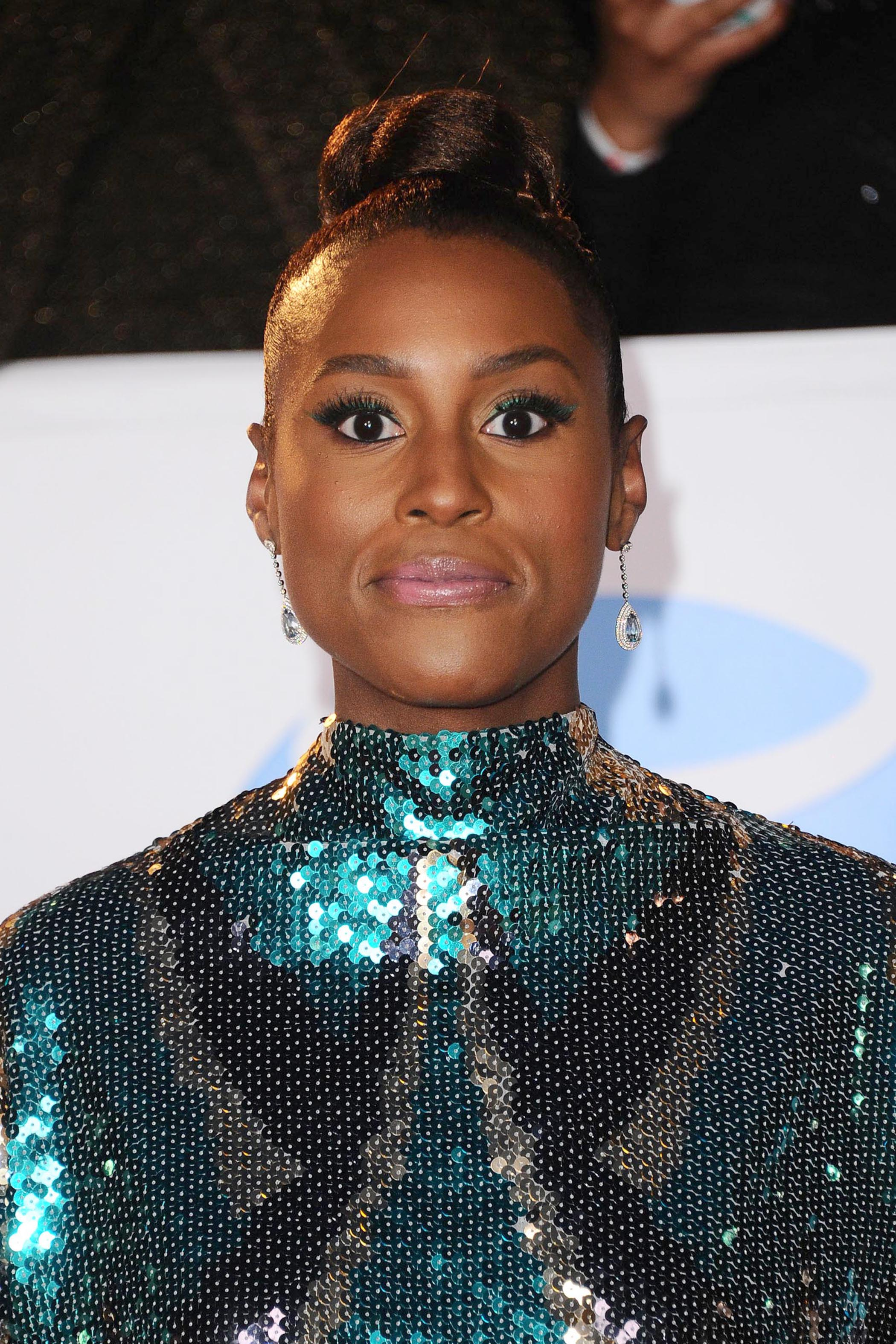 Actress Issa Rae at the NAACP Image Awards with a high bun hairstyle