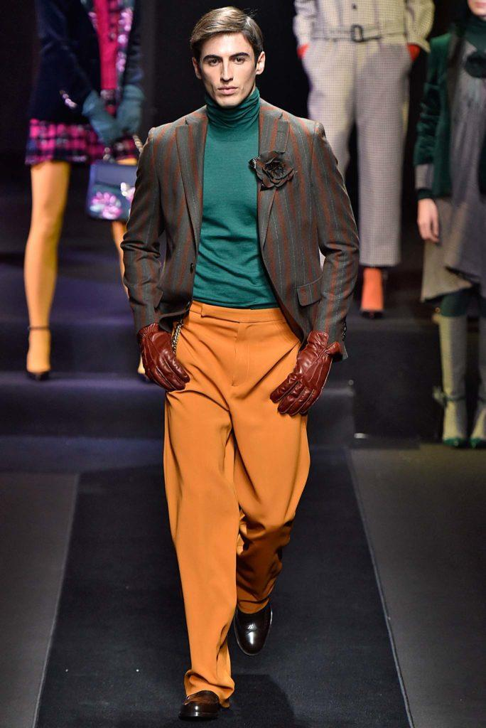 male model on catwalk with side part comb over on light brown hair