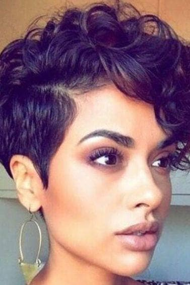 woman with medium brown curly pixie hair