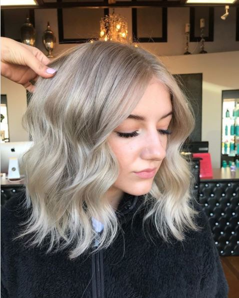 woman with blonde ombre hair on shoulder length hair