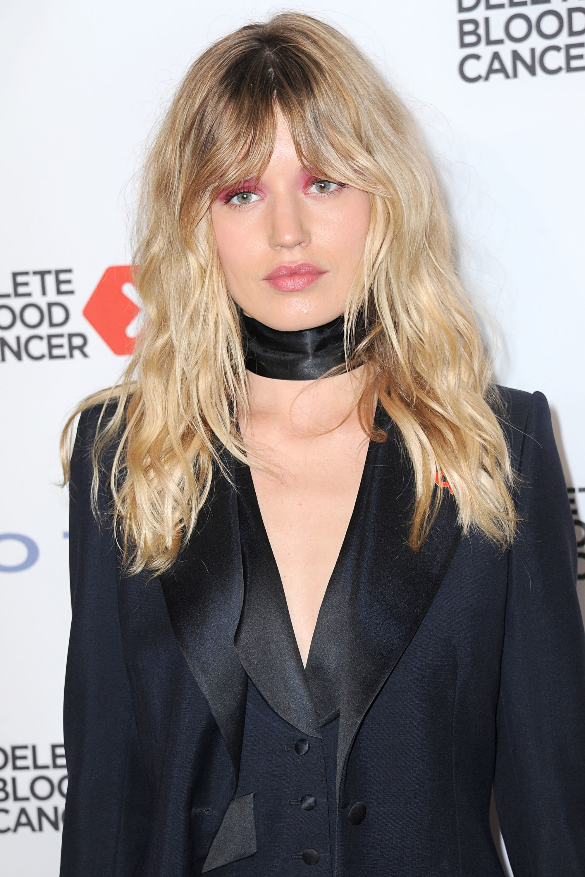 close up shot of georgia may jagger with black jacket, choker and split bangs hairstyle on the red carpet