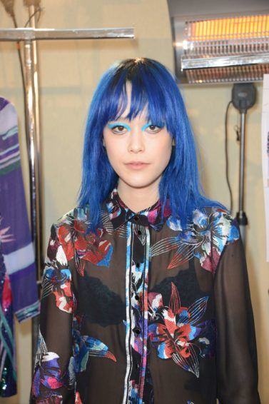 woman with blue medium length hair and fringe