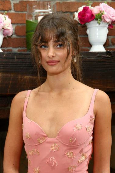 model taylor hill with long wavy bangs and a ponytail