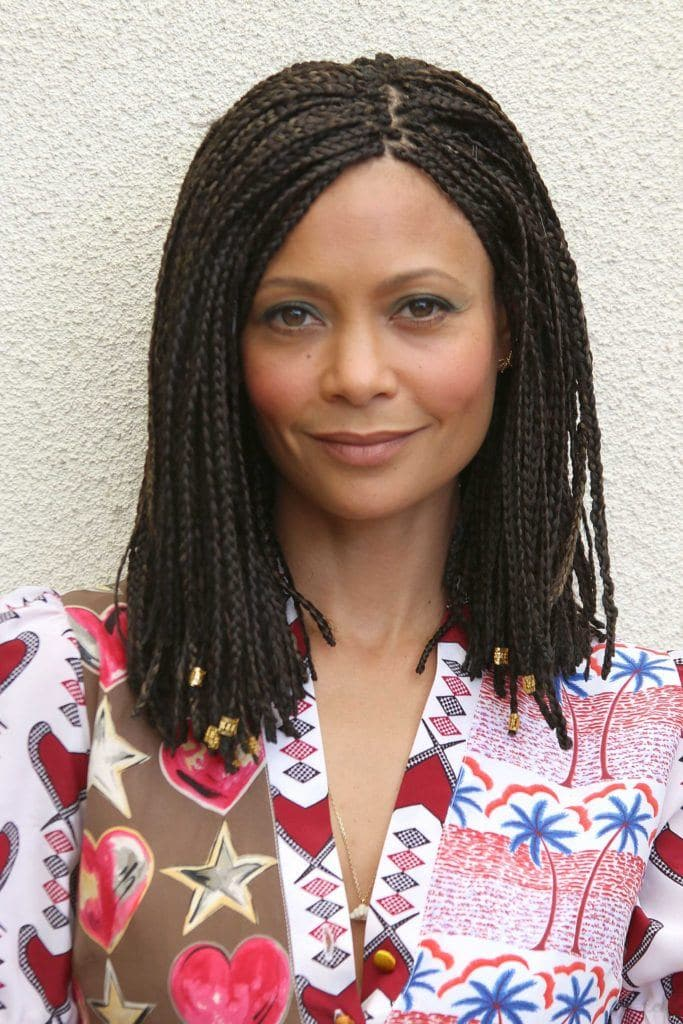 braided black hair bobs: close up shot of thandie newton with box braided bob hairstyle, wearing floral top