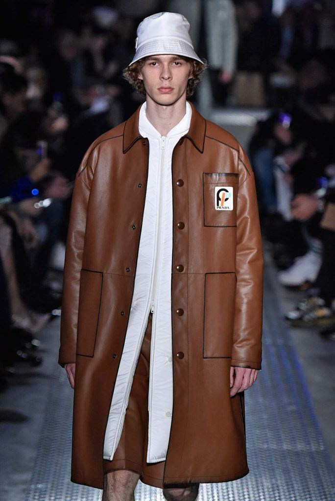 male model on catwalk with bucket hat accessory