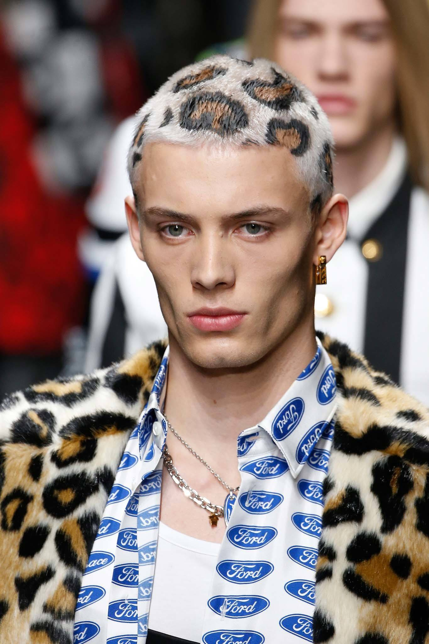 Milan Fashion Week Men's AW19: Runway shot of a Versace model with a platinum blonde leopard print buzz cut