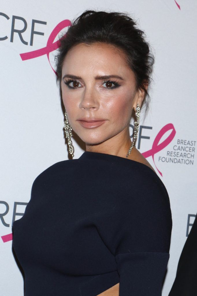 triangle face hairstyles: victoria beckham with her dark hair in an updo style
