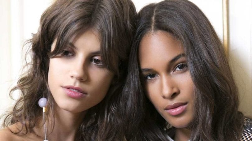 Wavy hair tips and tricks two brunette girls backstage at fashion show