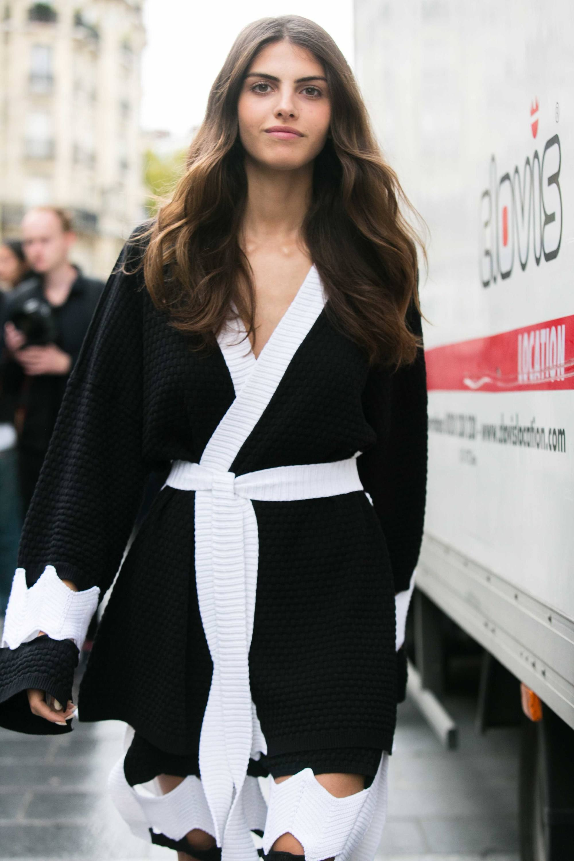Wavy hair tips Girl with long brunette wavy hair outside a show at fashion week walking