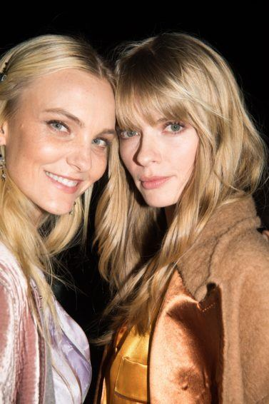 Purple shampoo: Blonde models backstage at fashion show with long hair