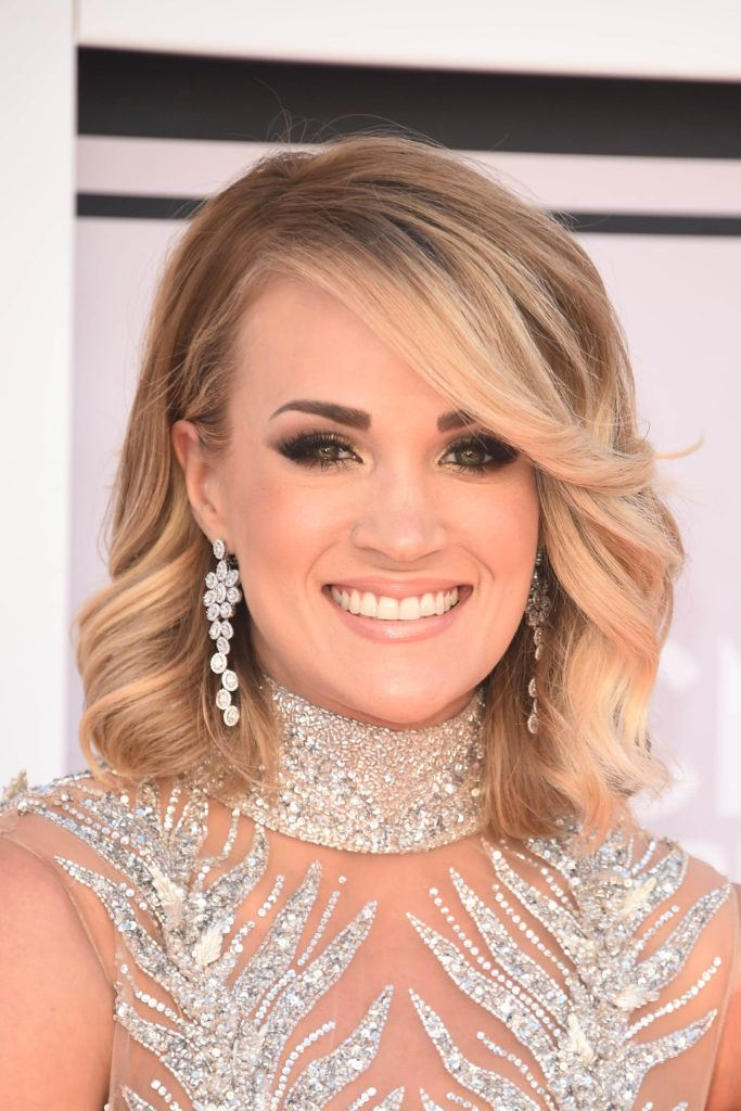 country singer carrie underwood with curled swoop bangs