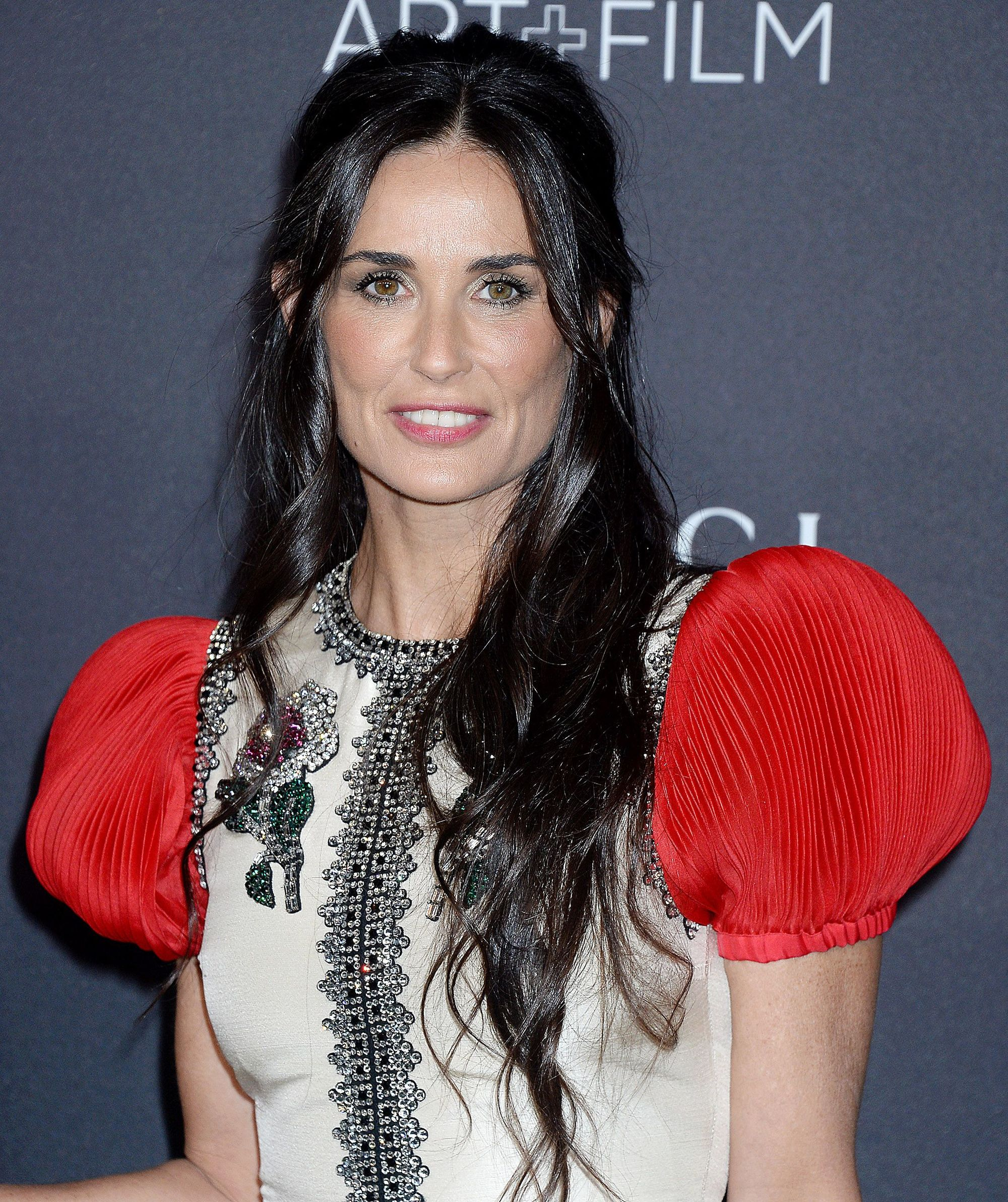 demi moore long dark brown wavy hair in half-up, half-down finish
