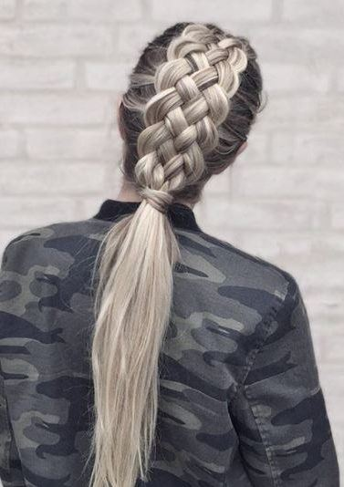 back view of woman with long blonde straight hair with 5 strand braided ponytail wearing camouflage jacket