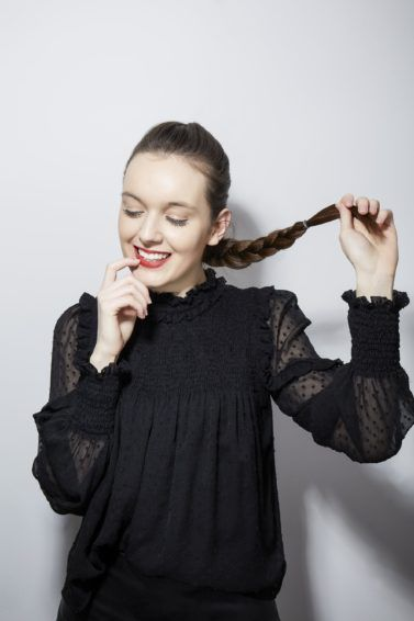 How to french braid your own hair brunette girl holding her braid