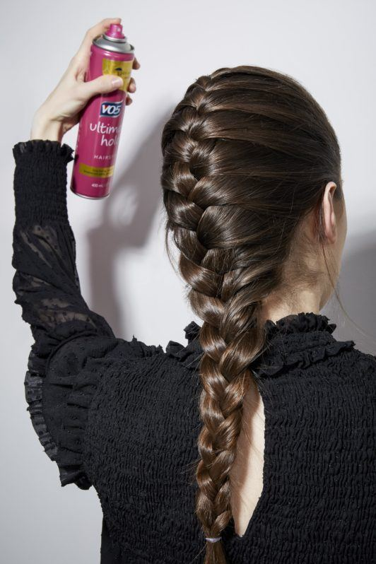 How to french braid your own hair brunette girl spraying hairspray