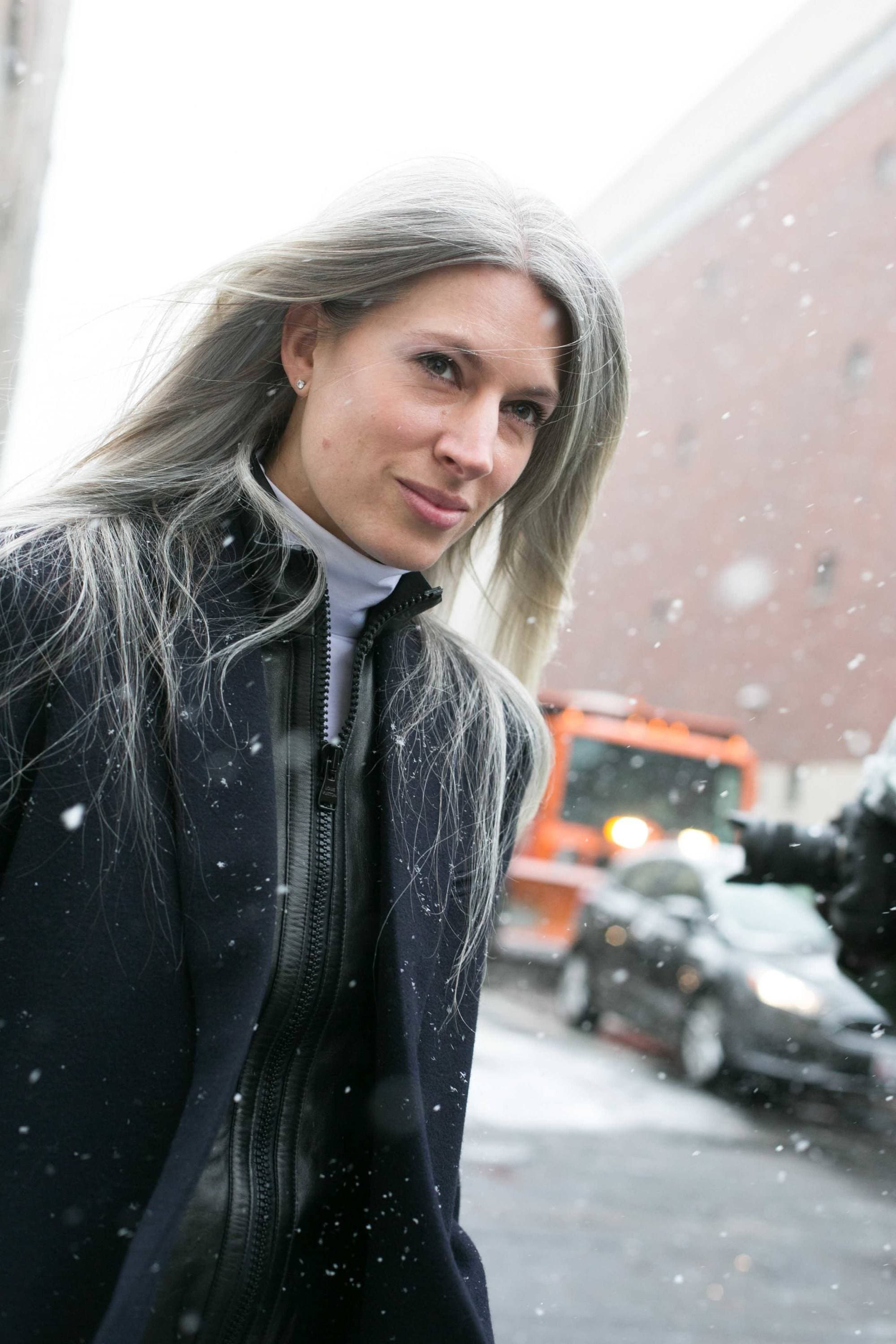 What causes grey hair Sarah Harris from British Vogue with long silver hair outside