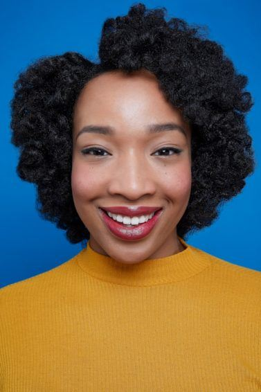 Flexi rods on natural hair girl smiling with afro hair