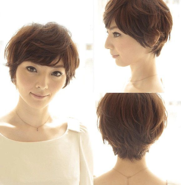 Asian hairstyles: Asian woman with short layered light brown pixie hair.
